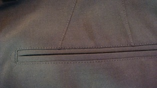 Example of top stitch around the back pocket and darts.