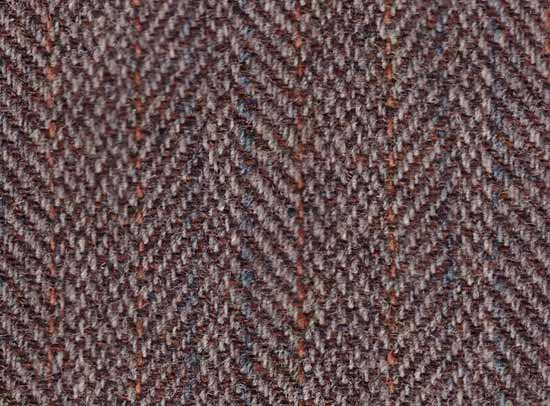 Tweed with subdued colour tones woven as a herringbone pattern